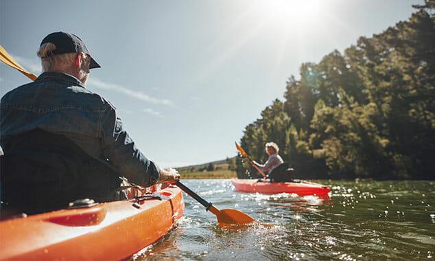 older couple kayaking