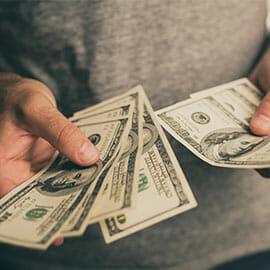 hands holding cash