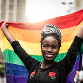 woman waving rainbow flag